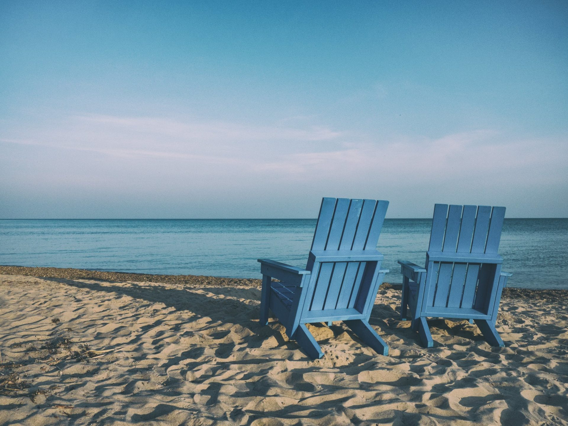 image of chairs at the beaching looking to the ocean